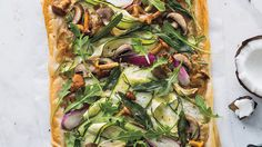 Using melted coconut oil beautifully complements this tart's toppings, which are much lighter than your typical bacon, ham or cheese. The first layer is a caramelized onion cream made with onions, garlic and coconut milk; then you arrange shaved zucchini, thinly sliced green onions and sliced mushrooms on top. After baking, you scatter arugula over everything and you've got a pizza-like dish that tastes fresh and not at all weighed down.