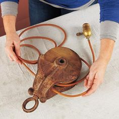 to Use a Barn Pulley to Make a Wall-Mount Light Fixture rustic pulley lamp diy @ This Old House Magazine. Pulley came from my Etsy shop: rustic pulley lamp diy @ This Old House Magazine. Pulley came from my Etsy shop: Rustic Lighting, Industrial Lighting, Kitchen Lighting, Modern Lighting, Lighting Ideas, Vintage Lighting, Rustic Light Fixtures, Modern Lamps, Lighting Design