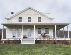 an all-time fave: exterior of white farmhouse with porch.  Photograph by Michael Luppino for Country Living