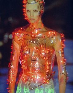 Cyborg. Programmed flashing LEDs mounted on transparent PetG body-hugging bodice , vac-formed from plaster body-cast. Concept by Alexander McQueen . Designed and made by Studio van der Graaf London. Alexander McQueen for Givenchy catwalk , Paris.