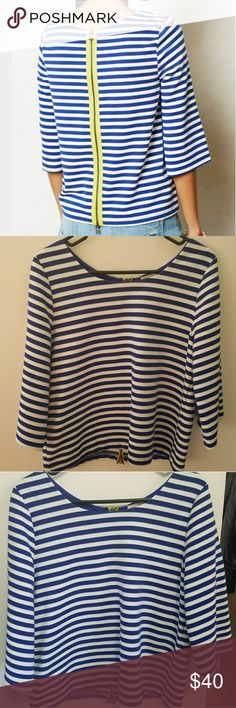 Anthropologie postmark striped top w/back zipper Blue and white striped top with a full back zipper from the anthropologie brand Postmark.  This top has three-quarter length sleeves, a loose, baggy fit, and a classic design. The green lining around the zipper adds a fun pop of color!  The fabric is a thicker blend, so no worries about it being see-through!  Excellent condition, no stains or pilling. Zipper works perfectly. Overall mistakable for brand new.  Freshly steam cleaned. Size…