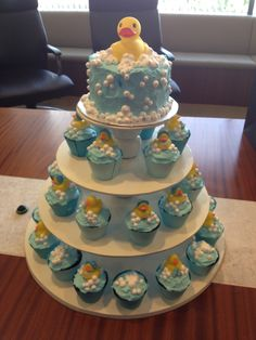 gorgeous rubber ducky themed cake and matching cupcakes