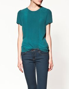 I don't know why I've never considered such a simple embellishment before. Just a pintucked t-shirt