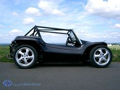 Manx Dune Buggy with full  cage. All dressed up in Tuxedo Black and Street Wheels.