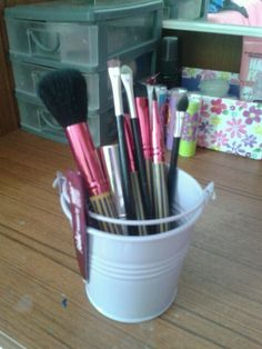 Make up brushes in a miny bucket