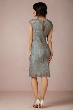 """Shined Lace Shift STYLE: 29946498 We love how Mignon Doo juxtaposes the edginess of metallic with the femininity of lace on this fitted dress. Side zip. Polyester metallic lace; rayon, polyester lining. Dry clean. Imported. Falls 23"""" from natural waist"""