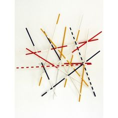 """Shangai coat hanger -  From a fun night, while playing this entertaining game to obtain the highest score, the idea of """"Shangai"""" was born, taking inspiration from the famous chinese game (also known as Mikado). The colorful sticks are transformed in bars to support hats, coats or shirts, welded to each other in a random arrangement."""