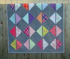 Mo Bedell made this bright and fun quilt using her upcoming Hothouse Flowers collection, and used one of our textured Chambray's for the background. Click on the picture to download the free pattern and make your own variation. @Maureen Mitchell Bedell