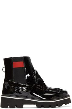 Ankle-high patent leather Chelsea boots in black. Round moc toe. Fringed trim at vamp. Elasticized gusset with red trim at sides. Pull-loop at heel counter. Tonal treaded rubber 'extra light' sole featuring stripe in white. Tonal stitching.