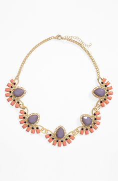 This coral fan statement necklace is perfect for festival season.