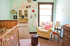Love the color on the wall and the glass knobs on wood dresser. Little girlie room