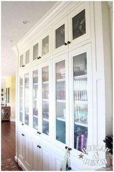 Built in White Buffet in Kitchen -- love the type of glass used here, as well as having lots of see into storage.