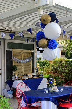 I love the lantern and pom chandelier.  Another beautiful and creative party from Party Wishes.