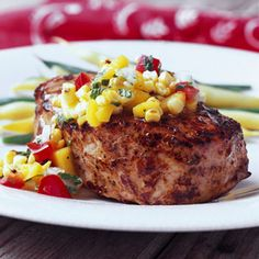 Summer Pork Chops with Corn-Mango Salsa Combine grilled fresh sweet corn and mango to make the yummy salsa recipe to served over these thick grilled pork chops.