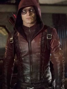 You can now easily get your Arsenal Red Arrow Jacket that is in hooded leather style inspired by Roy Harper who plays the role of right hand of Green Arrow. Red Arrow Dc, Roy Arrow, Arrow Cw, Green Arrow, Supergirl 2015, Supergirl And Flash, Arsenal Arrow, Colton Haynes Arrow, Arrow Roy Harper