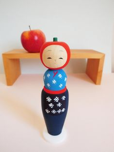 Apple kokeshi doll by Tayama Izumi, inspired by the apple trees of Iwate prefecture. Brand new and vailable on Folkeshi.com