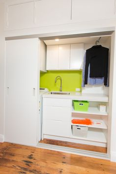 Laundry Sally Steer Design Ltd. laundry in a hallway with triple sliding doors and feature splashback. Laundry Design, Splashback, Sliding Doors, Sally, Apartments, Cabinet, Storage, Furniture, Ideas