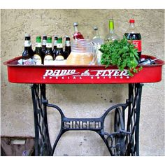 Instantly fell in love with this: Child's wagon and old Singer sewing machine base creates a great server for ice cold drinks.
