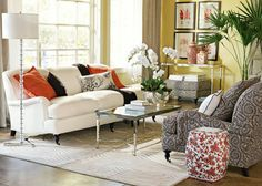 yellow, white, chocolate brown, coral living room via house and home and williams sonoma home