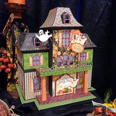 BlueMoon Scrapbooking:  with a Halloween house using G45 Erie Tales collection from the Utah mixed media show; July 2014