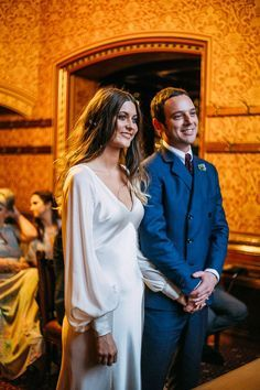 The light champagne 'May' dress of heavy silk crepe backed satin, cut on the bias with v neck and chevron panels and with added chiffon sleeves. For more pictures of this bride and photo credits please go to http://glorydaysyork.co.uk/brides/collection/kerry Manchester Town Hall 1930s 1970s bride wedding gown bishop sleeves gathered sleeves cuffs long sleeved wedding dress slinky simple stylish elegant cool bride