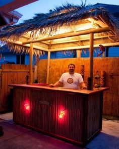 This is the centerpiece of the backyard. I built this long tiki bar, which sits underneath an 8 x thatched roof. Deck Bar, Pool Bar, Patio Bar, Roof Deck, Tikki Bar, Outdoor Tiki Bar, Outdoor Bar Furniture, Furniture Ideas, Gazebos