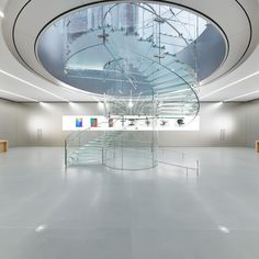 Glass cylinder entryway of the Apple Store (in Jiefangbei downtown) in Chongqing (China)