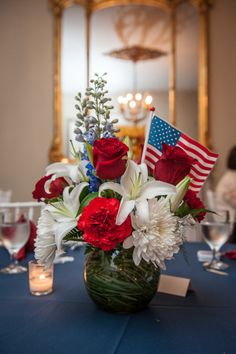 Patriotic centerpiece: http://www.stylemepretty.com/new-york-weddings/greenport/2015/03/11/elegant-veterans-day-wedding-at-brecknock-hall/ | Photography: Caroline Rocchetta - http://carolinerocchetta.com/