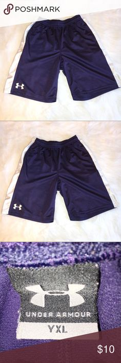 UNDER ARMOUR YOUTH XL NAVY BLUE AND WHITE SHORTS UNDER ARMOUR YOUTH XL NAVY BLUE AND WHITE SHORTS. SOME PULLS IN THREADS IN FRONT AND BACK. HARDLY NOTICEABLE IN PHOTOS. PLEASE LOOK AT PHOTOS. BUNDLE TO SAVE. Under Armour Bottoms Shorts