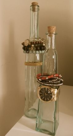 Out of sight, out of mind? Ever find yourself not wearing your jewelry because it's not displayed? These bottles will solve that problem! Makes bracelets and watches so easy to see and organized! Not to mention an attractive table top decoration! Have fresh flowers, stick them in the bottles too!