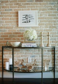 Demilune foyer table + Exposed brick wall + Vignette- Really like this table! Style At Home, Boho Deco, Interior Decorating, Interior Design, Decorating Ideas, Foyer Decorating, Decor Ideas, Condo, Transitional Living Rooms
