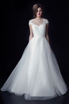 illusion neckline wedding dress by Heidi Elnora from fall 2014 bridal market | via junebugweddings.com