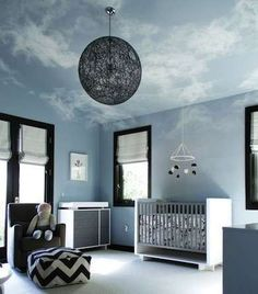 In the Clouds The extreme angles of dormered ceilings can make a room feel tight, but painted clouds on the ceiling and upper walls softened the edges for an airy look. The white clouds add a feeling of expansiveness to a simple and clean blue-and-black room.