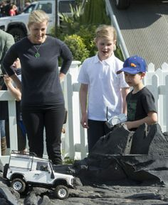Sophie, Countess of Wessex with her two children Lady Louise Windsor and James Viscount Severn as they play on the remote control Land Rover stand at the Royal Windsor Horse Show 2014 at Home Park in Windsor, England