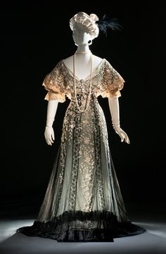 This evening gown is a delicate confection of silk satin, silk tulle, and thousands of hand-tinted and hand-embroidered glass bugle beads. It was once owned by the internationally famous beauty Consuelo Vanderbilt (1877–1964), who at the time she donned this creation was the 9th Duchess of Marlborough.