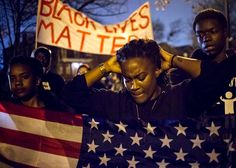 Protesters march to demand the criminal indictment of police officer Darren Wilson—who fatally shot unarmed black teenager Michael Brown in August 2014—in Ferguson, Missouri on Nov. 23, 2014.