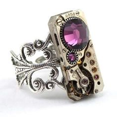 This Steampunk Ring is made with a beautiful rectangle clockwork design. While the tick and the tock has stopped, the mechanism is sure to come back to life as a piece of silver and purple wonderment upon your finger!  The Ring is made with a Vintage Ruby Jeweled Watch Movement and is embellished with stunning Purple Amethyst Crystals.