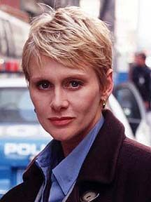 Andrea Thompson as Detective Jill Kirkendall in NYPD Blue