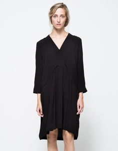 From Just Female, a lightweight long sleeve dress with dropped waist in black.  Features deep V neckline, cuffed sleeve, front pockets, gathered skirt, dropped waist seam in back, finished edges, rounded high-low hem, lined body and relaxed fit throughout