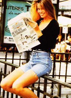 """Claudia Schiffer reading Liberation. """"Das Lustgesicht, Das Schokolade Weint."""" Bunte, October 1989. Schiffer originally wanted to become a lawyer and used to work in her father's law firm. She later dropped these aspirations when, in October 1987 at 17, she was spotted in a nightclub in Düsseldorf by Michel Levaton, the boss of Metropolitan Model Agency who signed her up to become a model."""