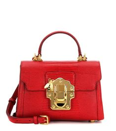 Dolce & Gabbana - Lucia Mini leather crossbody bag - Crafted from embossed red leather for an exotic, glamorous look, this shoulder bag from Dolce & Gabbana is a timelessly elegant piece. The golden hardware and charming bee at the front elevate the structured silhouette for enduring ladylike appeal. Carry yours in the crook of your arm to lunch. seen @ www.mytheresa.com