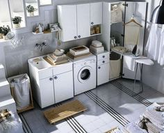 White Laundry Room Cabinets With Soft White Ikea Laundry Room Cabinet Ikea Laundry Room, White Laundry Rooms, Modern Laundry Rooms, Laundry Room Cabinets, Basement Laundry, Laundry Room Organization, Small Laundry, Laundry Room Design, Laundry Area