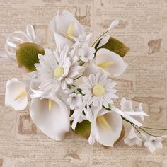 White Gumpaste Daisy & Calla Lily Spray Sugarflower cake topper perfect for cake decorating fondant cakes, wedding cakes, and cupcakes.  No more making your own flowers.  Simply purchase, take out of the box, and decorate your cake. | CaljavaOnline.com #caljava #fondx