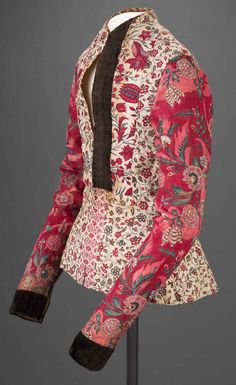 * Woman's short Jacket ('kassekijntje', Coromandel Coast, India (chintz), and Hindeloopen, The Netherlands (construction), mid-18th century. Cotton, mordant- and resist-dyed, and painted; jacket, pieced from three patterns of chintz, bodice lined and padded with cotton, sleeves lined with printed cotton, trimmed with silk velvet and Dutch weft-patterned tape (langetband). #Friesland #Hindeloopen