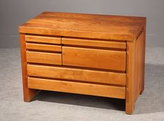 A Pierre Chapo massive elm commode, of a rectangular shape, with seven drawers.  Pierre Chapo (1927-1987) is born in a family of craftmen. After his regular studies, he worked for...