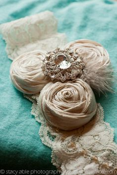 vintage garter. Used flowers that matched the wedding dress and brooches that match the brooch bouquet.