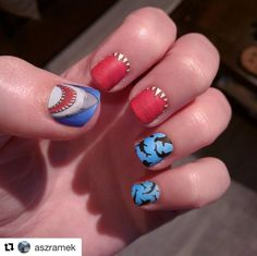 "aszramek(IG) wearing Espionage Cosmetics ""Shark"" nail wraps! For a manicure with a lil bite... #EspionageCosmetics #NerdManicure #NerdNails #GeekNails #NailArt #NailWraps #Nailspiration #Sharks #SharkWeek #SharkNails"