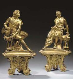 En bronze ciselé et doré, l'un représentant une femme assise vêtue d'une draperie à l'antique et flanquée d'une salamandre, l'autre Jupiter et un phénix, sur une base ornée d'une palmette stylisée et terminée en volutes<br>Hauteur: 44,5 cm. (17 1/2 in.), Largeur: 23 cm. (9 in.) (2)