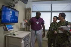 United States Navy Lt. Michael Hendrick, an intensive care unit nurse at Naval Hospital Camp Pendleton, demonstrates to Master Sgt. Mitsuyoshi Nakashima and 1st Lt. Hiroyasu Goto of the Japan Ground Self-Defense Force, Western Army Infantry Regiment, the video conferencing abilities available at the in-patient rooms at Naval Hospital Camp Pendleton, during Exercise Iron Fist 2016 on Marine Corps Base Camp Pendleton, Calif., Feb. 3. Iron Fist is an annual, bilateral amphibious training…