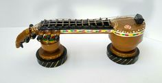 These miniature veena is made with waste Xerox papers.